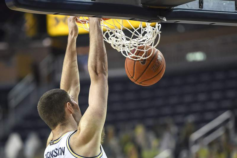 Hunter Dickinson #1 of the Michigan Wolverines dunks the ball against the UCF Knights during the first half at Crisler Arena on December 06, 2020 in Ann Arbor, Michigan.