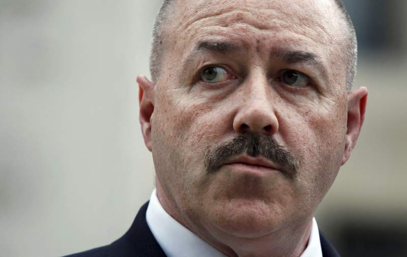 FILE - In this June 4, 2009, file photo, former New York City police Commissioner Bernard Kerik stands outside the Federal Court in Washington. On Wednesday, Feb. 19, 2020, Kerik, who was New York City's police commissioner during the Sept. 11 attacks, said he started crying when President Donald Trump told him he was being pardoned for felony convictions that put him behind bars for three years. (AP Photo/Manuel Balce Ceneta, File)