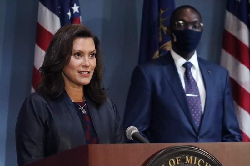 FILE - In this Wednesday, Sept. 2, 2020 file photo provided by the Michigan Office of the Governor, Gov. Gretchen Whitmer addresses the state during a speech in Lansing, Mich. Gov. Whitmer's office said Thursday, Sept. 17, 2020, her requirement that athletes wear masks applies to Big Ten football in Michigan, but a face shield will suffice for players and the administration is open to potentially changing the order. (Michigan Office of the Governor via AP, File)