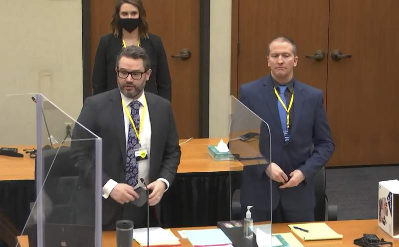 In this image taken from video, defense attorney Eric Nelson, left, and defendant former Minneapolis police officer Derek Chauvin, right, and Nelson's assistant Amy Voss, back, introduce themselves to potential jurors as Hennepin County Judge PeterCahill presides, prior to continuing jury selection, Monday, March 15, 2021, in the trial of Chauvin, at the Hennepin County Courthouse in Minneapolis, Minn. Chauvin is charged in the May 25, 2020, death of George Floyd.   (Court TV, Pool via AP)