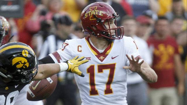 Quarterback Kyle Kempt #17 of the Iowa State Cyclones drops back to throw during the second half under pressure from defensive end Anthony Nelson #98 of the Iowa Hawkeyes on September 8, 2018 at Kinnick Stadium, in Iowa City, Iowa. (Photo by Matthew Holst/Getty Images)
