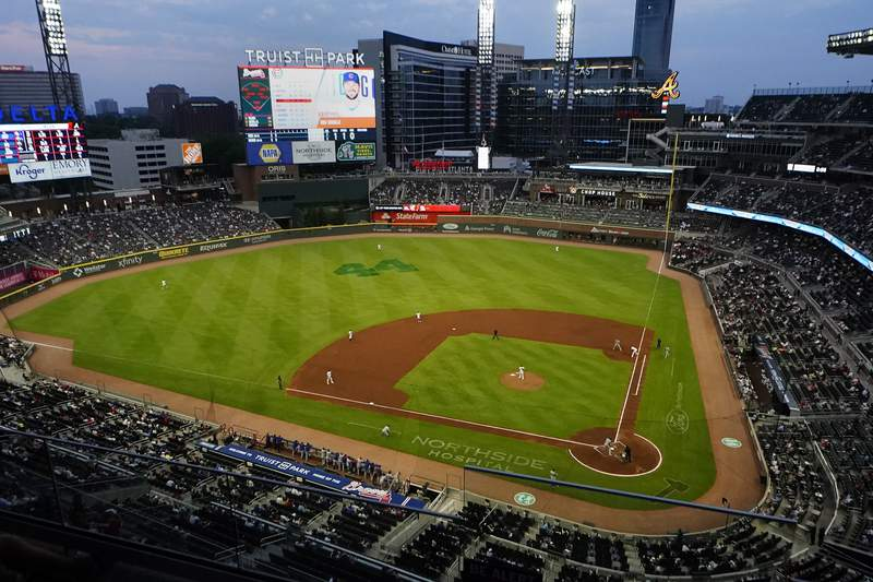 The Chicago Cubs play the Atlanta Braves at Truist Park in a baseball game Thursday, April 29, 2021, in Atlanta. The Braves announced they plan to expand attendance limits to full capacity beginning May 7. (AP Photo/John Bazemore)