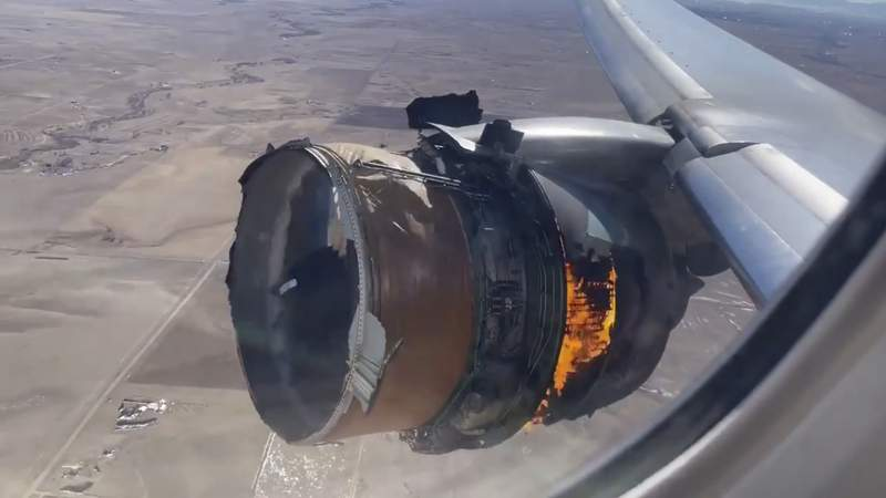 """FILE - In this file photo taken from video, the engine of United Airlines Flight 328 is on fire after experiencing """"a right-engine failure"""" shortly after takeoff from Denver International Airport, Saturday, Feb. 20, 2021, in Denver, Colo. Two passengers who were on board the United Airlines airplane that had to make an emergency landing are suing the company in separate suits filed Friday, April 16 in Chicago, where United is based. (Chad Schnell via AP, File)"""