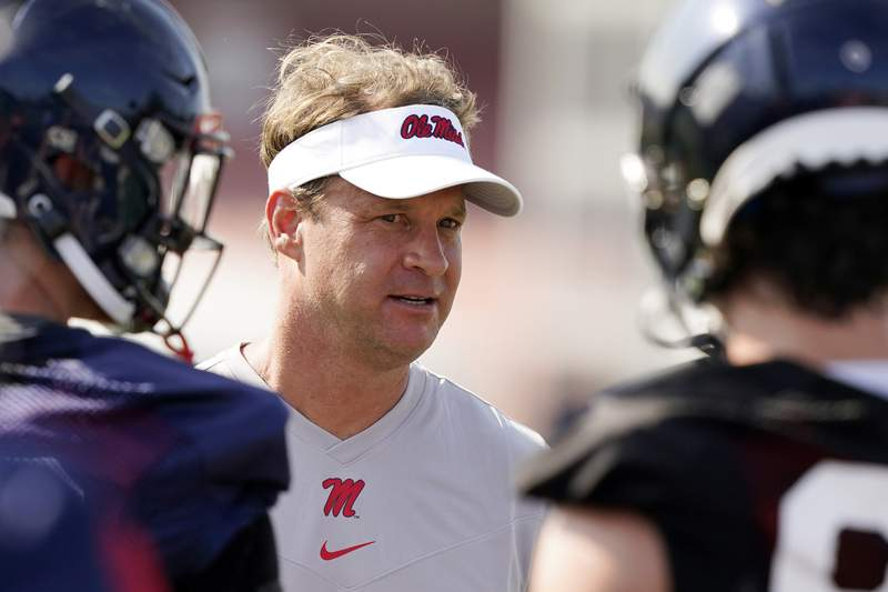 FILE - In this Aug. 9, 2021, file photo, Mississippi coach Lane Kiffin speaks with his players during NCAA college football practice in Oxford, Miss., Monday,. Mississippi takes on Louisville in Monday nights Chick-Fil-A Kickoff game that wraps up college footballs first full weekend.   (AP Photo/Rogelio V. Solis, File)