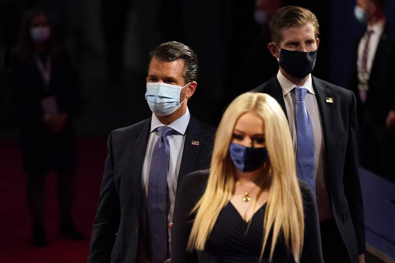 Tiffany Trump, Donald Trump Jr. and Eric Trump arrive before the first presidential debate Tuesday, Sept. 29, 2020, at Case Western University and Cleveland Clinic, in Cleveland, Ohio. (AP Photo/Julio Cortez)