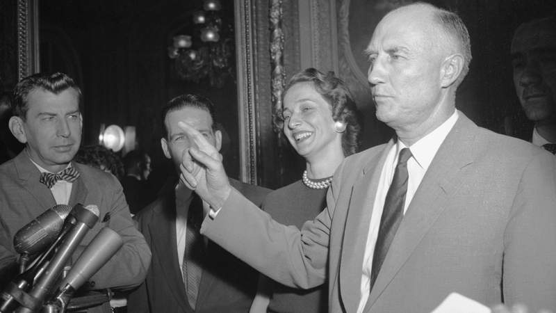 Senator Strom Thurmond (D-S.C.) is mobbed by reporters as he steps from the Senate Chamber after ending his 24-hour, 18-minutes talkathon against the Civil Rights Bill.
