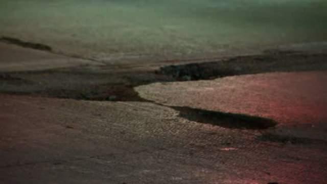 A massive pothole on a Michigan road.