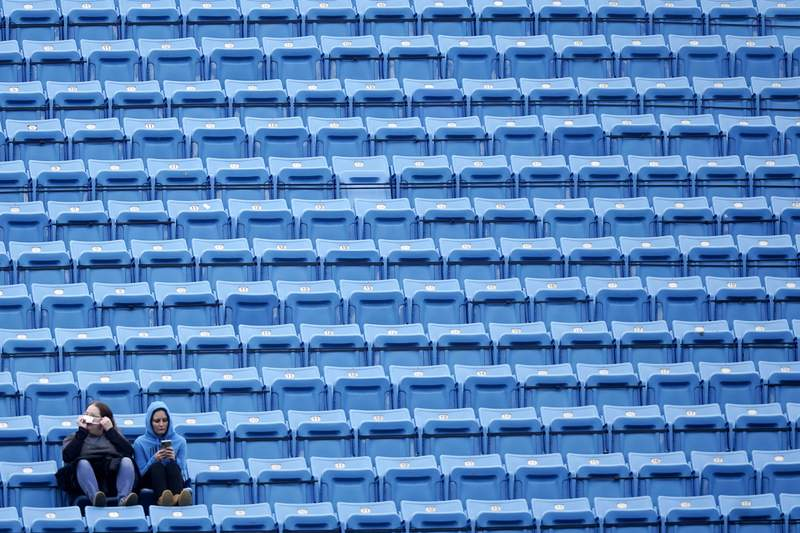 Fans sit in the stands before the first half of an NFL football game between the Carolina Panthers and the Tampa Bay Buccaneers, Sunday, Nov. 15, 2020, in Charlotte , N.C. (AP Photo/Gerry Broome)