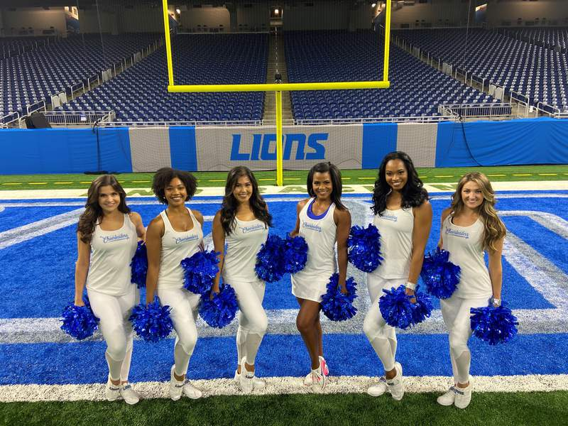 Rhonda Walker poses after practice with Lions Cheerleaders