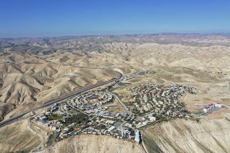 """FILE - This Jan. 26, 2020, file photo, shows a view of the West Bank Jewish settlement of Mitzpe Yeriho. The United Nations Human Rights Council released a list of more than 100 companies it says are operating in Israel's West Bank settlements. In a report Wednesday, Feb. 12, 2020, the council said the companies' activities """"raised particular human rights concerns. The list is dominated by Israeli companies, but it also lists a number of international firms. (AP Photo/Oded Balilty, File)"""