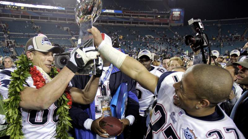 Rodney Harrison #37 and Christian Fauria #88 of the New England Patriots celebrate with the Lombardi Trophy after defeating the Philadelphia Eagles in Super Bowl XXXIX. That was last time a team repeated as Super Bowl champs. (Photo by Brian Bahr)