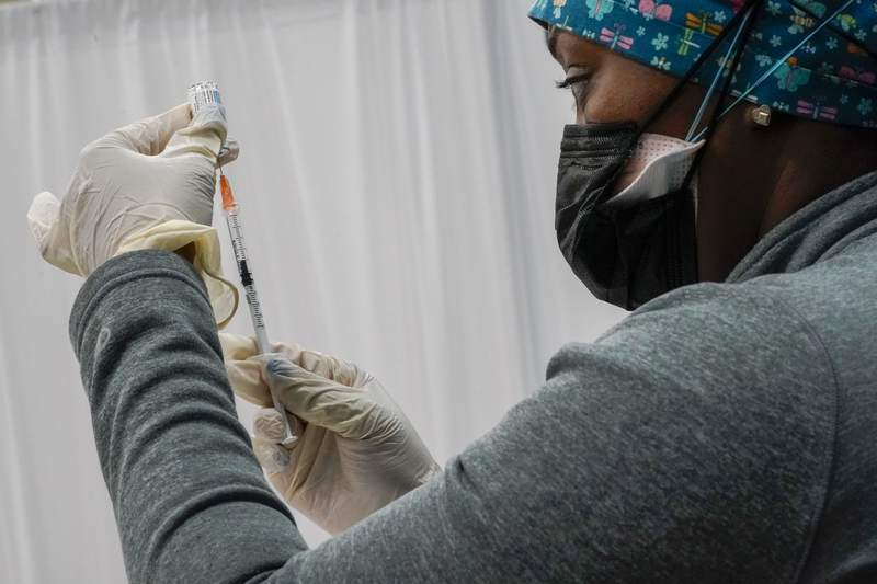 A Northwell Health registered nurse fills a syringe with the Johnson & Johnson COVID-19 vaccine at a pop up vaccination site inside the Albanian Islamic Cultural Center, Thursday, April 8, 2021, in the Staten Island borough of New York. (AP Photo/Mary Altaffer)