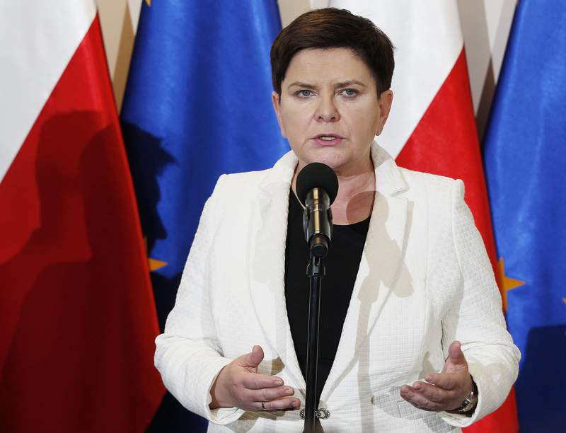 FILE - In this Thursday, April 18, 2019 file photo, Poland's Deputy Prime Minister Beata Szydlo speaks to reporters in Warsaw, Poland. Relatives of former Polish Auschwitz prisoners are protesting the appointment of a top member of the countrys right-wing ruling party to an advisory council at the state-run Auschwitz-Birkenau museum in Poland. They argue that the former prime minster, Beata Szydlo, has tolerated openly fascist groups and supported attempts to stifle research into the Holocaust.  (AP Photo/Czarek Sokolowski, file)