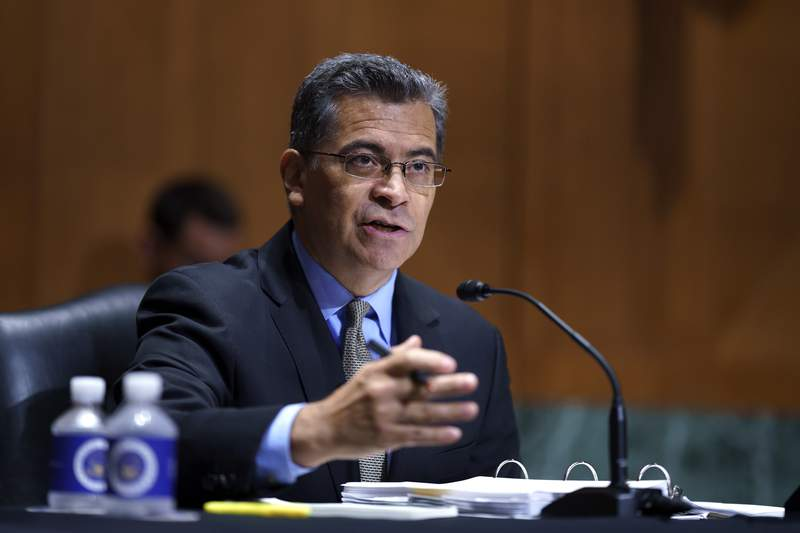 FILE - In this June 10, 2021, file photo, Health and Human Services Secretary Xavier Becerra testifies before the Senate Finance Committee on Capitol Hill in Washington. The Biden administration Thursday, July 1, began putting in place consumer protections against surprise medical bills enacted in bipartisan legislation signed last year by former President Donald Trump. (AP Photo/J. Scott Applewhite, File)