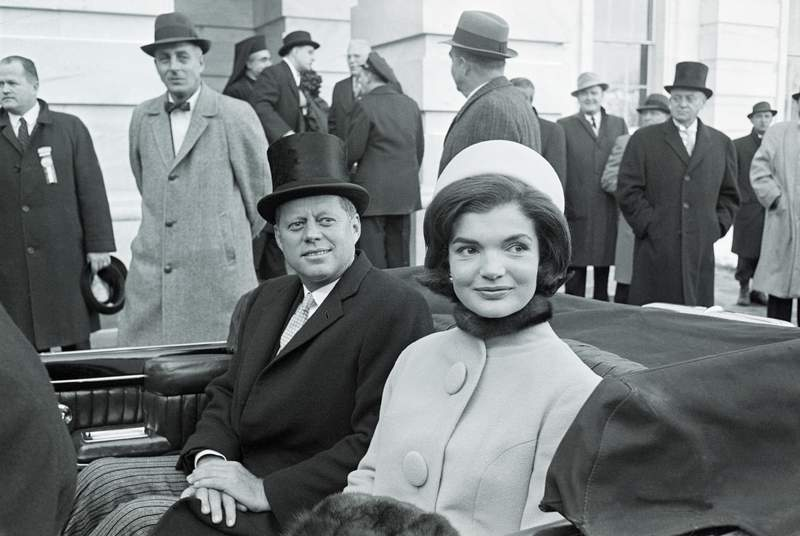 """President John F. Kennedy and first lady Jacqueline Kennedy leave the Capitol building by car shortly after the former took the oath of office as president of the United States on Jan. 20, 1961. President Kennedy, 43, the youngest man ever elected to the presidency, called for a global alliance against """"tyranny, poverty, disease and war."""""""