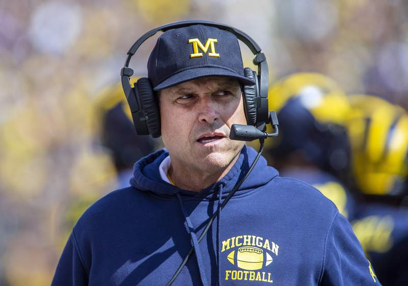FILE - In this Sept. 7, 2019, file photo, Michigan head coach Jim Harbaugh is shown on the sidelines in the first half of an NCAA college football game against Army in Ann Arbor, Mich. (AP Photo/Tony Ding, File)