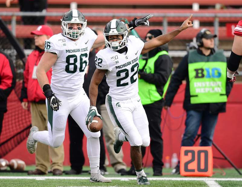 Josiah Scott #22 of the Michigan State Spartans react during the second half of their game against the Rutgers Scarlet Knights at SHI Stadium on November 23, 2019 in Piscataway, New Jersey.