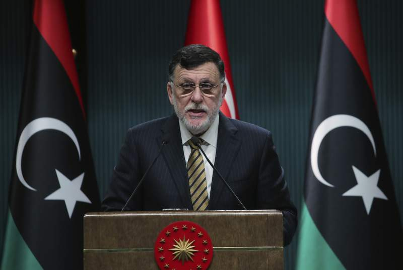 FILE - In this June 4, 2020 file photo, Fayez Sarraj, the head of Libya's internationally-recognized government, speaks at a joint news conference with Turkey's President Recep Tayyip Erdogan, in Ankara, Turkey.   Libyas U.N.-supported government Friday, Aug. 21, 2020, announced a cease-fire across the oil-rich country and called for demilitarizing the strategic city of Sirte, which is controlled by rival forces.  (Turkish Presidency via AP, Pool)