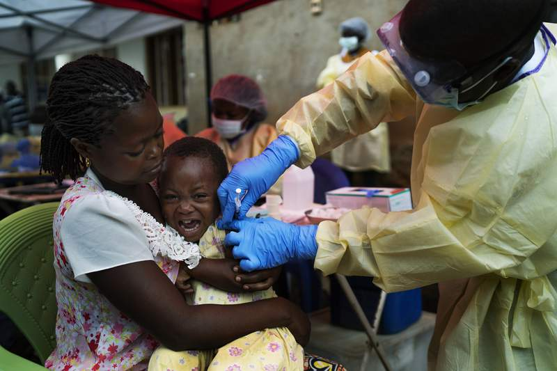 FILE - In this Saturday, July 13, 2019 file photo, a child is vaccinated against Ebola in Beni, Congo. The World Health Organization said officials have begun vaccinating people in eastern Congo against Ebola, after it was confirmed last week that the disease killed a toddler. In a statement on Wednesday, Oct. 13, 2021 the U.N. health agency said people at high risk of catching the disease, including the young boy's family members and health workers, would receive the first doses of the vaccine made by Merck.(AP Photo/Jerome Delay, file)
