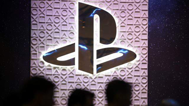 Attendees walk by the Sony PlayStation booth at the 2019 GDC Game Developers Conference on March 20, 2019 in San Francisco, California. (Photo by Justin Sullivan/Getty Images)