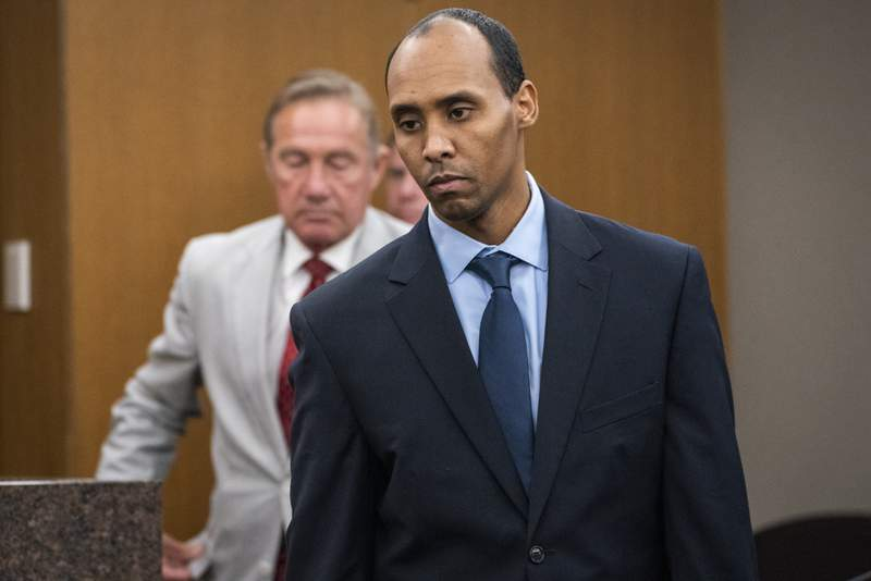 FILE - In this June 7, 2019 file photo, former Minneapolis police officer Mohamed Noor walks to the podium to be sentenced at Hennepin County District Court in Minneapolis. The Minnesota Supreme Court on Wednesday, Sept. 15, 2021, reversed the third-degree murder conviction of Noor who fatally shot an Australian woman in 2017, saying the charge doesn't fit the circumstances in this case. (Leila Navidi/Star Tribune via AP, Pool File)
