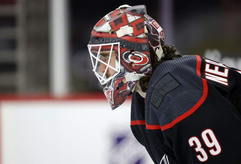Alex Nedeljkovic of the Carolina Hurricanes looks on during the first period of their game against the Detroit Red Wings at PNC Arena on March 04, 2021 in Raleigh, North Carolina.
