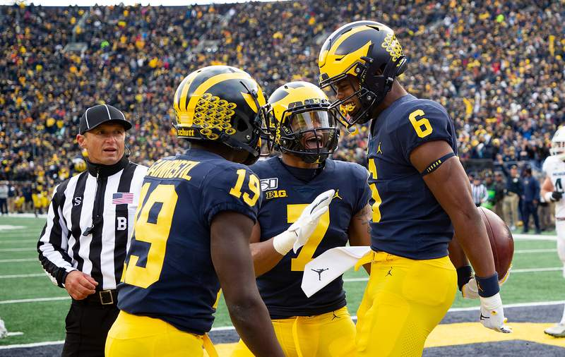 Cornelius Johnson #6 of the Michigan Wolverines celebrate a fourth quarter touchdown during the game against the Michigan State Spartans at Michigan Stadium on November 16, 2019 in Ann Arbor, Michigan. Michigan defeated Michigan State 44-10.