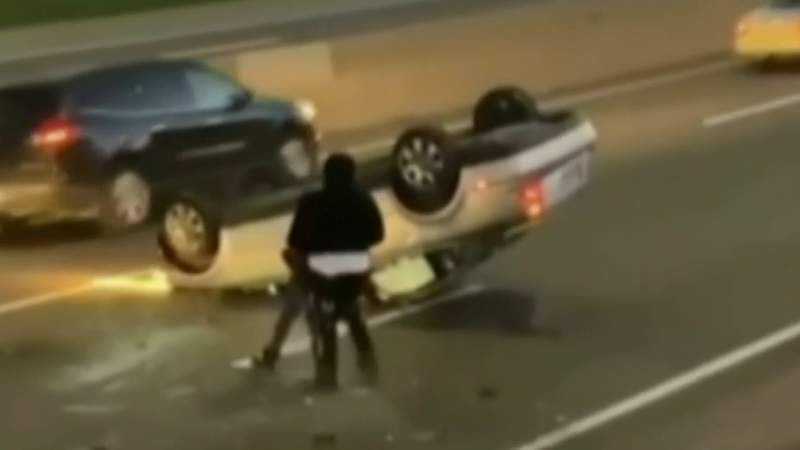 Good samaritans stop to help woman trapped inside crashed car on I-94