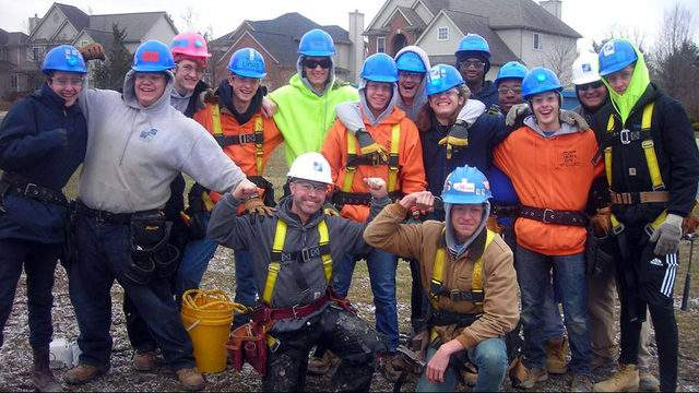 Students pose at a building site on March 4, 2019. (Credit: Ann Arbor Student Building Industry Program)