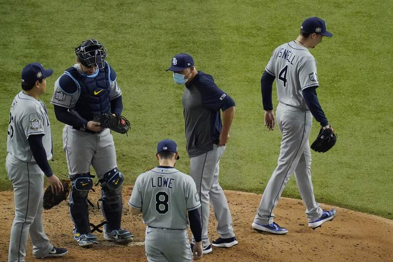 Tampa Bay Rays starting pitcher Blake Snell leaves the game against the Los Angeles Dodgers during the sixth inning in Game 6 of the baseball World Series Tuesday, Oct. 27, 2020, in Arlington, Texas. (AP Photo/Sue Ogrocki)