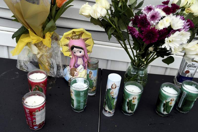 A memorial is seen on Monday, May 10, 2021, outside a mobile home in Colorado Springs, Colo., where a shooting at a party took place a day earlier that killed six people before the gunman took his own life. (AP Photo/Thomas Peipert)