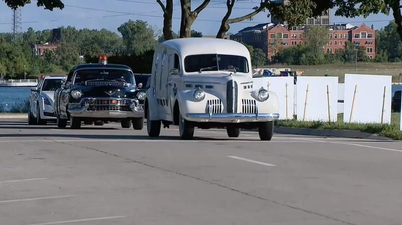 A procession of vehicles on Belle Isle for Detroit Memorial Day on Aug. 31, 2020. Th day honored COVID-19 victims in the city.