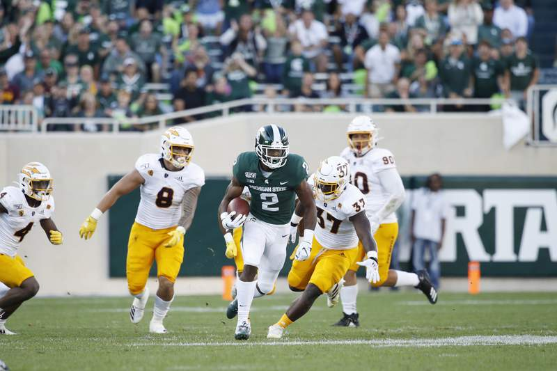 Julian Barnett #2 of the Michigan State Spartans runs with the ball during the game against the Arizona State Sun Devils at Spartan Stadium on September 14, 2019 in East Lansing, Michigan. Arizona State defeated Michigan State 10-7.