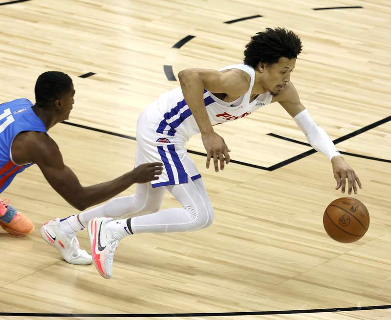 LAS VEGAS, NEVADA - AUGUST 08:  Cade Cunningham #2 of the Detroit Pistons grabs a loose ball against the Oklahoma City Thunder during the 2021 NBA Summer League at the Thomas & Mack Center on August 8, 2021 in Las Vegas, Nevada. The Thunder defeated the Pistons 76-72.  NOTE TO USER: User expressly acknowledges and agrees that, by downloading and or using this photograph, User is consenting to the terms and conditions of the Getty Images License Agreement.  (Photo by Ethan Miller/Getty Images)
