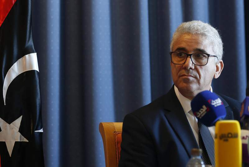 FILE - In this Dec. 26, 2019 file photo, Libyan Interior Minister Fathi Bashagha speaks during a news conference in Tunis, Tunisia. The motorcade of the interior minister of Libyas U.N.-backed government came under attack on Sunday, Feb. 21, 2021, in the capital, Tripoli, a government spokesman said. Bashagha survived the attack. (AP Photo/Hassene Dridi, File)