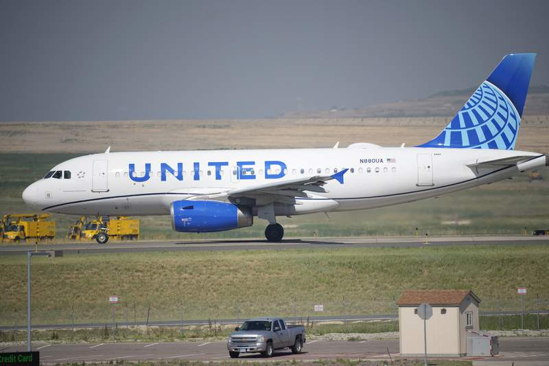 FILE - In this July 2, 2021 file photo, a United Airlines jetliner taxis down a runway for take off from Denver International Airport in Denver.   The vast majority of United Airlines employees are deciding to get vaccinated against COVID-19 rather than risk losing their job. United said Wednesday, Sept. 22,  that more than 97% of its U.S.-based employees are fully vaccinated.  (AP Photo/David Zalubowski, file)