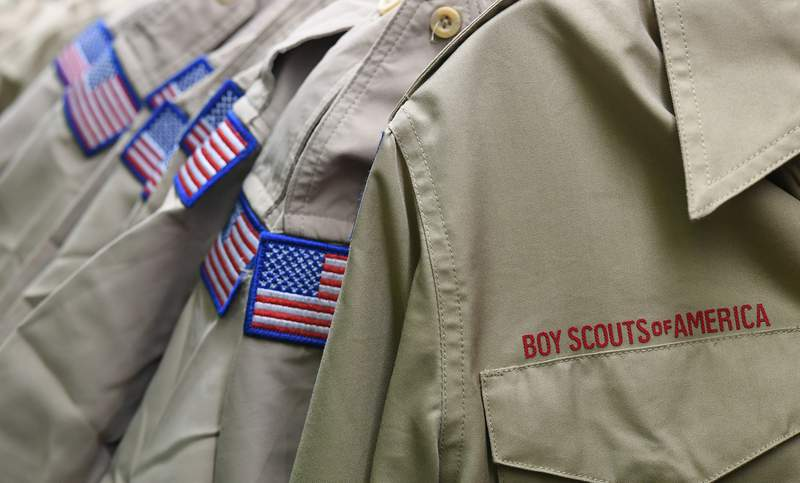 FILE - In this Feb. 18, 2020, file photo, Boy Scouts of America uniforms are displayed in the retail store at the headquarters for the French Creek Council of the Boy Scouts of America in Summit Township, Pa.   Nine sex-abuse lawsuits were filed Tuesday, May 19 2020, in upstate New York against three Boy Scout local councils, signaling an escalation of efforts to pressure councils nationwide to pay a big share of an eventual settlement in the Scouts bankruptcy proceedings. The lawsuits were filed shortly after an easing of coronavirus lockdown rules enabled courts in some parts of New York to resume the handling of civil cases.  (Christopher Millette/Erie Times-News via AP, File)