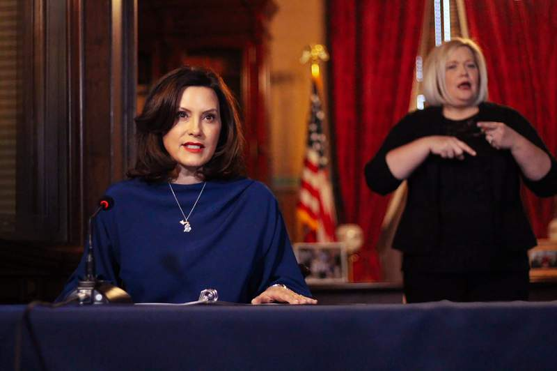In a pool photo provided by the Michigan Office of the Governor, Michigan Gov. Gretchen Whitmer addresses the state during a speech in Lansing, Mich., Monday, March 30, 2020. (Michigan Office of the Governor via AP, Pool)