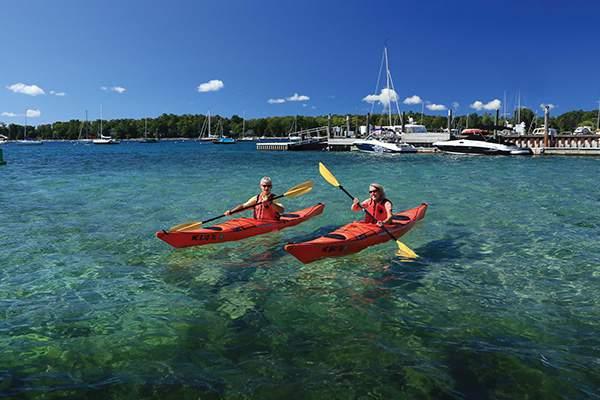 Two women kayaking.