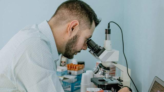 Detox Day Spa owner Anthony Beven analyzes a blood sample. Contributed photo.
