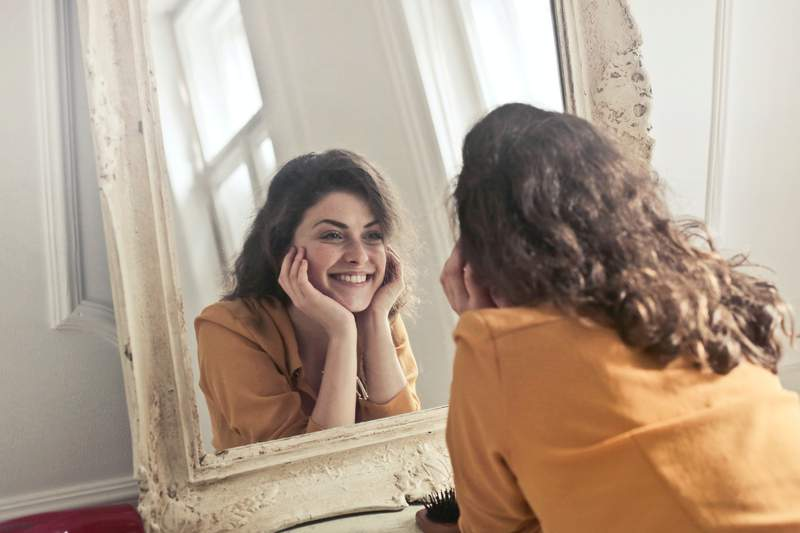 A woman looking in the mirror