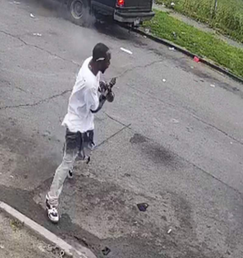 A photo of the unknown man wanted for shooting a father and son.
