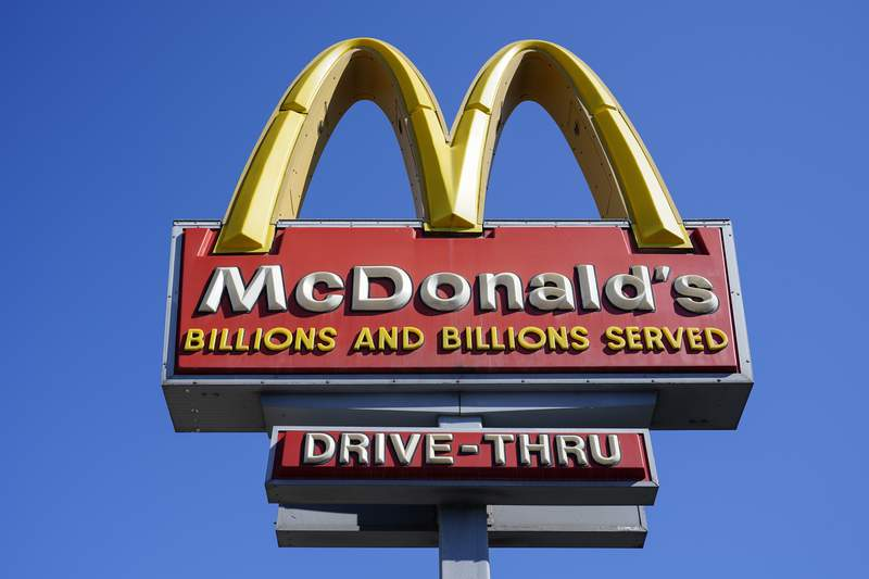 A McDonald's sign is shown in Philadelphia, Monday, April 26, 2021. McDonalds posted better-than-expected sales in the second quarter as dining rooms reopened and new products like the Crispy Chicken Sandwich drew customers. Revenue jumped 57% to nearly $5.9 billion in the April-June period. That beat Wall Streets forecast of $5.6 billion, according to analysts polled by FactSet. (AP Photo/Matt Rourke)