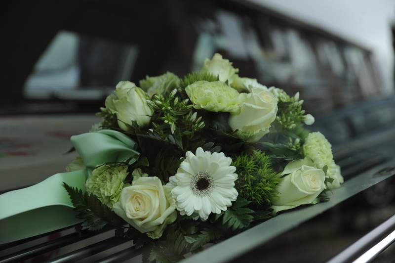 Pictured are flowers at a funeral.