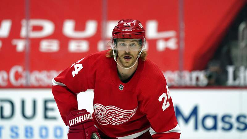Detroit Red Wings defenseman Jon Merrill plays during the third period of an NHL hockey game, Sunday, March 28, 2021, in Detroit. (AP Photo/Carlos Osorio)