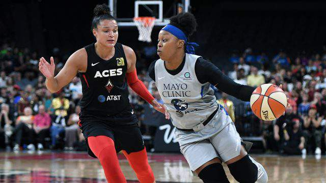 LAS VEGAS, NEVADA - JULY 21: Odyssey Sims #1 of the Minnesota Lynx drives against Kayla McBride #21 of the Las Vegas Aces during their game at the Mandalay Bay Events Center on July 21, 2019 in Las Vegas, Nevada. The Aces defeated the Lynx 79-74. (Photo by Ethan Miller/Getty Images)