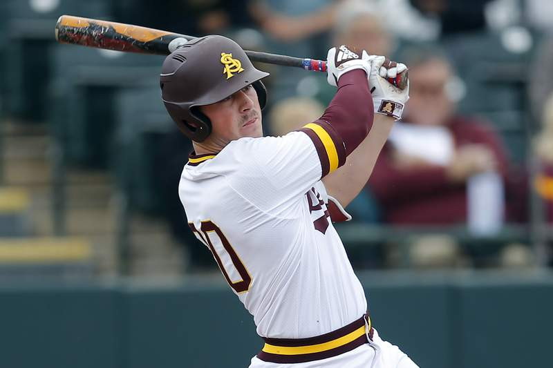 In this Feb. 17, 2019, photo, Arizona State's Spencer Torkelson bats during an NCAA college baseball game against Notre Dame in Phoenix. Detroit drafted Arizona State first baseman Spencer Torkelson with the top pick in this week's draft, although the Tigers plan to try him across the diamond at third base. (AP Photo/Rick Scuteri, File)
