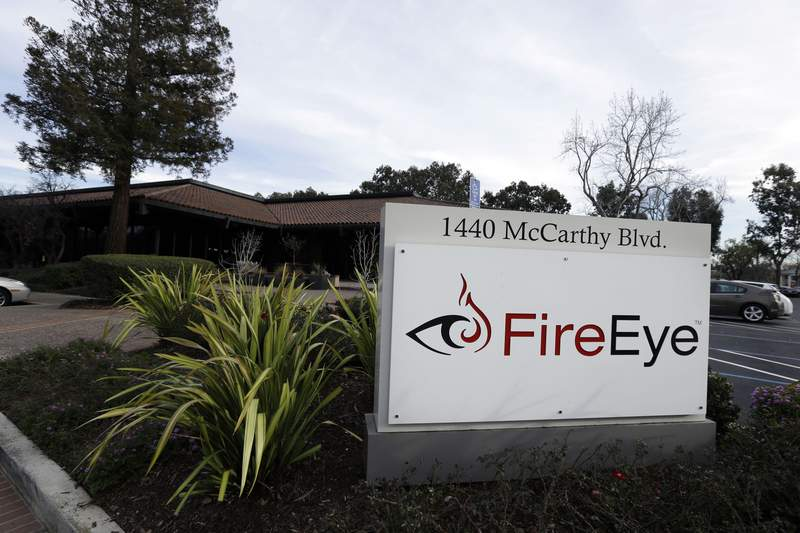 FILE - This Wednesday, Feb. 11, 2015 file photo shows FireEye offices in Milpitas, Calif. The cybersecurity firm that discovered a cyberespionage campaign that has badly shaken U.S. government agencies and the private sector says efforts to assess the impact and boot the intruders remain in their early stages. FireEye has released a tool and a white paper to help potential victims scour their installations of Microsoft's cloud-based email and collaboration software to determine if hackers broke in and remain active.  (AP Photo/Ben Margot, File)