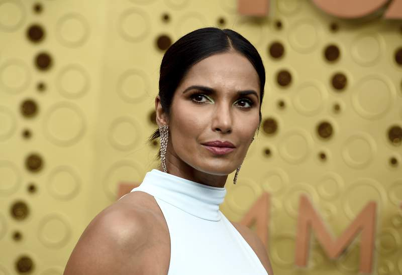FILE - In this Sept. 22, 2019 file photo, Padma Lakshmi arrives at the 71st Primetime Emmy Awards in Los Angeles. The Top Chef host and best-selling author is working on her first picture book, Tomatoes for Neela. Viking Childrens Books announced Tuesday that the book is scheduled for fall 2021. (Photo by Jordan Strauss/Invision/AP, File)