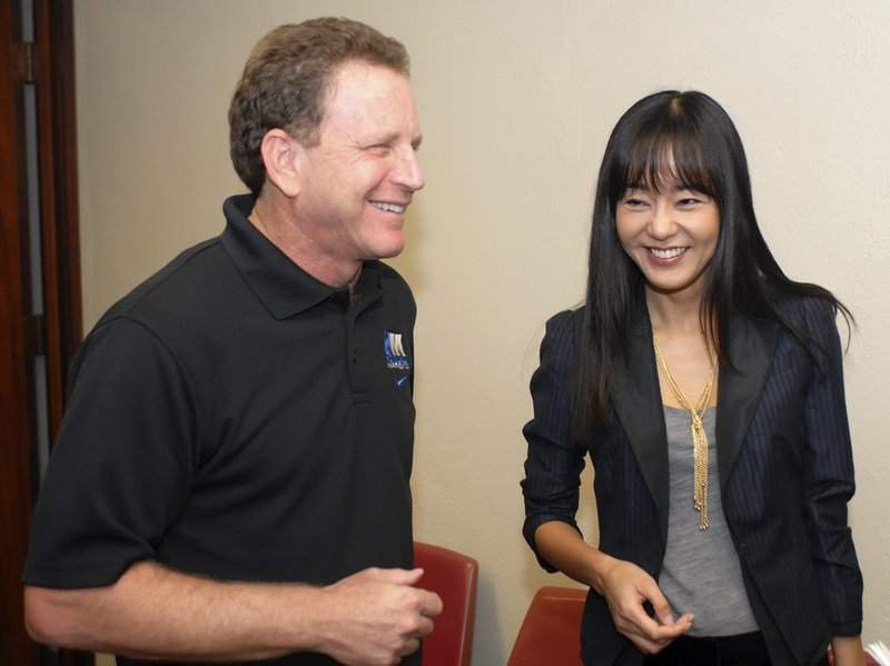 """FILE - In this Dec. 1, 2006 file photo Honolulu Marathon president and CEO Dr. James Barahal, left, shares a laugh with Yunjin Kim, right, of ABC's """"Lost"""" during a Honolulu Marathon news conference in Honolulu. Barahal has joined a chorus of former students by saying a late University of Michigan doctor performed a """"completely inappropriate"""" act on him during a medical examination in the 1970s. Barahal, who himself is a longtime physician, told The Associated Press in a telephone interview that Dr. Robert E. Anderson gave him a digital rectal exam when the then-medical student visited the student health center in 1975 complaining of a sore throat. (AP Photo/Ronen Zilberman)"""